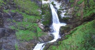 Waterfall in mountains, Aerial view, Alps Austria, glacier waterfall. stock footage