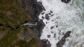 Aerial view of the beautiful waterfall at the coast at Malin Beg looking in County Donegal, Ireland.