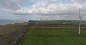 Aerial View. Beautiful windmill turbines , wind energy turbines . Aerial drone shot. 4K. 30fps stock video footage