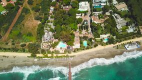 Aerial view of beautiful wood bridge `Puente Romano` - Marbella. Empty beach