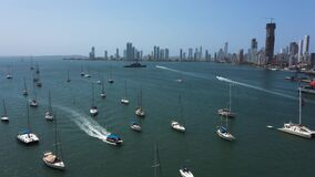 Aerial view of the Beautiful yachts drifting in the bay. A warship patrols the gulf.