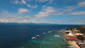 Aerial view beautiful beach on tropical island. Cebu island Philippines. Aerial view of beautifulisland with white sand beach, Moalboal, boats, hotels and Royalty Free Stock Image