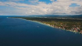Aerial view beautiful beach on tropical island. Cebu island Philippines. Aerial view of beautifulisland with white sand beach, Moalboal, boats, hotels and Stock Photography
