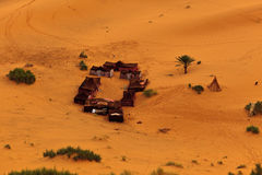 Aerial view of Bedouin tents in Sahara Desert. Aerial view of a group of Bedouin tents in the sand dunes of the Sahara Desert in Morocco Stock Photography
