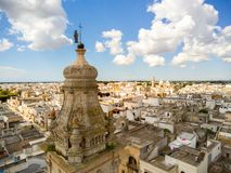 Aerial View of the Belltower of the Church of St. John Baptist in the Town of Sava, near Taranto, in the South of Italy. On Partially Cloudy Sky Background stock image