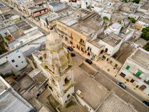 Aerial View of the Belltower of the Church of St. John Baptist in the Town of Sava, near Taranto, in the South of Italy. On Partially Cloudy Sky Background stock photo