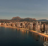 Aerial view of a Benidorm city coastline at sunrise. Spain. Aerial view of a Benidorm city coastline at sunrise. Benidorm is a modern resort city, one of the Stock Images