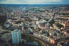 Aerial view of Berlin with skyline and scenery beyond the city, Germany, seen from the observation deck of TV tower. Sunny day Royalty Free Stock Image