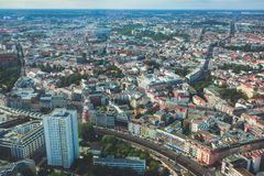Aerial view of Berlin with skyline and scenery beyond the city, Germany, seen from the observation deck of TV tower. Sunny day Royalty Free Stock Images
