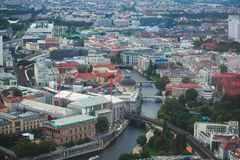 Aerial view of Berlin with skyline and scenery beyond the city, Germany, seen from the observation deck of TV tower. Sunny day Royalty Free Stock Photography
