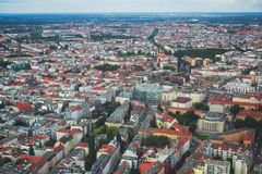 Aerial view of Berlin with skyline and scenery beyond the city, Germany, seen from the observation deck of TV tower. Sunny day Stock Photo
