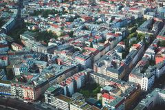 Aerial view of Berlin with skyline and scenery beyond the city, Germany, seen from the observation deck of TV tower. Sunny day Royalty Free Stock Photos