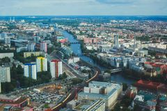 Aerial view of Berlin with skyline and scenery beyond the city, Germany, seen from the observation deck of TV tower. Sunny day Stock Image
