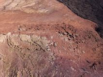 Aerial view of the Bermeja mountain of an intense red color, surrounded by lava fields, Lanzarote, Canary Islands, Spain. Aerial view of the Bermeja mountain of royalty free stock photo