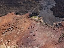 Aerial view of the Bermeja mountain of an intense red color, surrounded by lava fields, Lanzarote, Canary Islands, Spain. Aerial view of the Bermeja mountain of stock photo