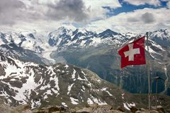 Aerial View of Bernina Mountain Range in Summer. With Swiss Flag in Foreground Royalty Free Stock Photos