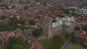Aerial view of Beverley Minster and the surrounding town in East Yorkshire, UK - 2019. Drone shot of the famous religious building and the surrounding town in stock video
