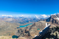 Aerial view of Bianco lake from Diavolezza. And the alps in Engadine area, Canton of Grisons, Switzerland Royalty Free Stock Images
