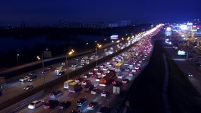 Aerial view of big city highway traffic jam in the evening rush hour Royalty Free Stock Image