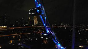 Aerial view on big ferris wheel in the modern city skyline, Singapore. View from drone. 1920x1080 stock video footage