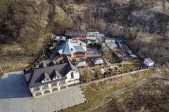 Aerial view of big house mansion complex on fenced property in ecological area on bright sunny day. Modern architecture, riches. And luxury concept stock image