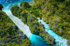Aerial view of The Big Lagoon entrance pass, Miniloc Island. Beautiful landscape scenery in El Nido, Philippines.  stock photos