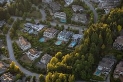 Aerial View of Residential Homes. Aerial view of the big luxury homes on the hill during a vibrant sunny summer day. Taken in West Vancouver, British Columbia stock image