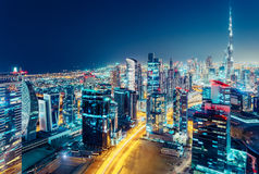 Aerial view of a big modern city at night. Nighttime skyline of Dubai, UAE. Stock Images