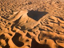 Aerial view on big sand dunes in desert royalty free stock photo