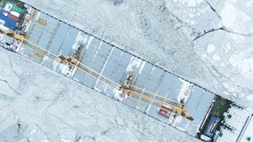 Aerial view. The big ship sails through the sea ice in the winter, close-up stock video footage