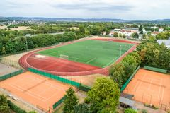 Aerial view of a big sports and soccer football field in a village near andernach koblenz neuwied in Germany. Aerial view of a smal sports soccer football field royalty free stock image