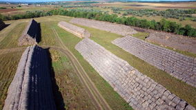 Aerial view of big stacks from hay bale stock video footage