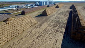 Aerial view of big stacks from hay bale.  stock footage