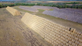 Aerial view of big stacks from hay bale stock footage