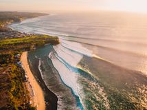 Aerial view of big stormy waves at warm sunset and beach. Biggest ocean wave in Bali. Aerial view of big stormy waves at warm sunset and beach. Biggest ocean stock photo