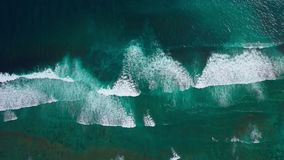 Aerial view of big turquoise ocean water and white waves crashing and foaming. Concept of nature stock video footage