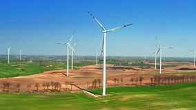 Aerial view of big wind turbines in spring, Poland stock footage