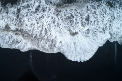 Aerial view of Black sand beach and ocean waves in Iceland stock images