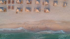 Aerial view of the Black Sea. Aerial landscape of beautiful sea beach and wooden sunshade umbrellas stock video footage
