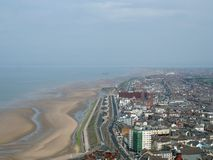 Aerial view of blackpool looking south showing the beach at low tide with the roads and buildings of the town and coast. An aerial view of blackpool looking stock photography