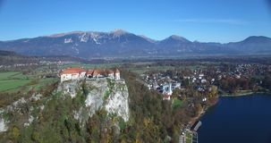 Aerial view of Bled Castle and Bled lake landscape stock footage