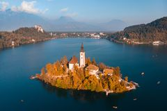 Aerial view of Bled island on lake Bled, and Bled castle and mountains in background, Slovenia. royalty free stock photography