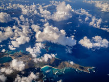Aerial view of blue Caribbean sea, and tropical islands dotted with clouds Stock Images