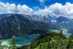 Aerial view of blue mountain lake between forested rocky mountains. Achensee, Austria, Tyrol Royalty Free Stock Photos