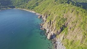 Aerial View Blue Ocean and Green Hilly Rocky Coast stock footage