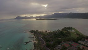 Aerial view of blue ocean and Mauritius Island. Aerial shot of Le Morne Brabant peninsula with yachts near the coast and distant mountain landscape. Mauritius stock video footage
