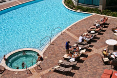 Aerial View of Blue Pool at Hotel with Sunbathers. Stock Photography