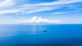 Aerial view blue sea water surface and blue sky, Beautiful white clouds on blue sky over calm sea with sunlight reflection, Oslob stock image