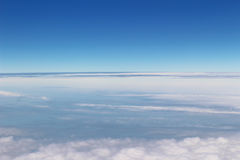Aerial view of Blue sky and Cloud Top view from airplane window Royalty Free Stock Images