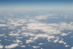 Aerial view of Blue sky and Cloud Top view from airplane window Stock Photos